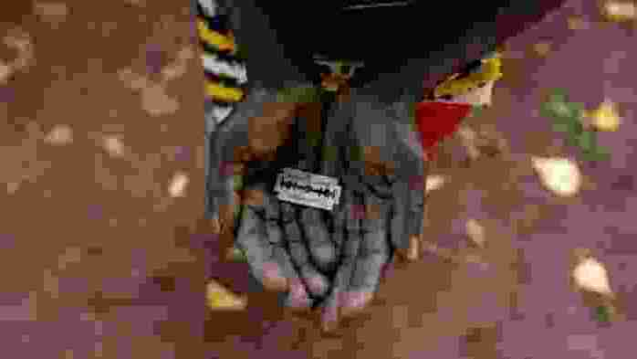 The photograph of a woman's hands showing the razorblade.