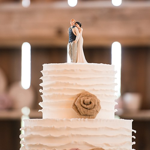Your Perfect Wedding Cake Topper is A Sweet Embrace Bride Embracing Groom Couple Figurine