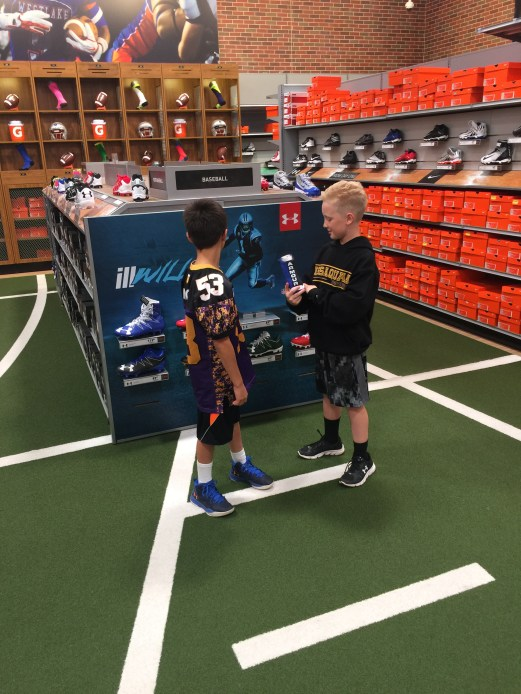 My son, Will, and his friend checking out Under Armour gear.