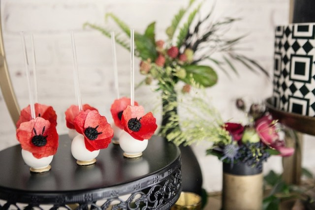 Wedding reception dessert table with cake pops with red sugar flowers