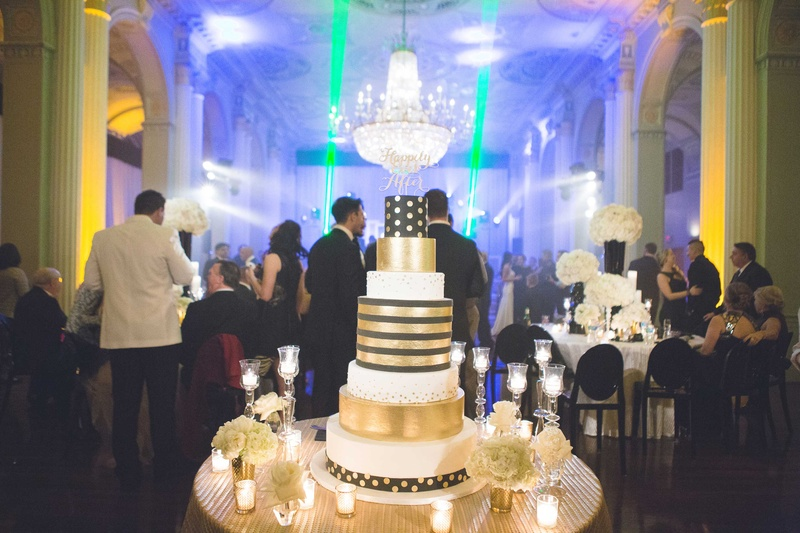 Cakes   Desserts Photos   Black  Gold   White Striped Cake   Inside     New Year s Eve wedding cake with gold stripes and polka dots under  chandelier NYE