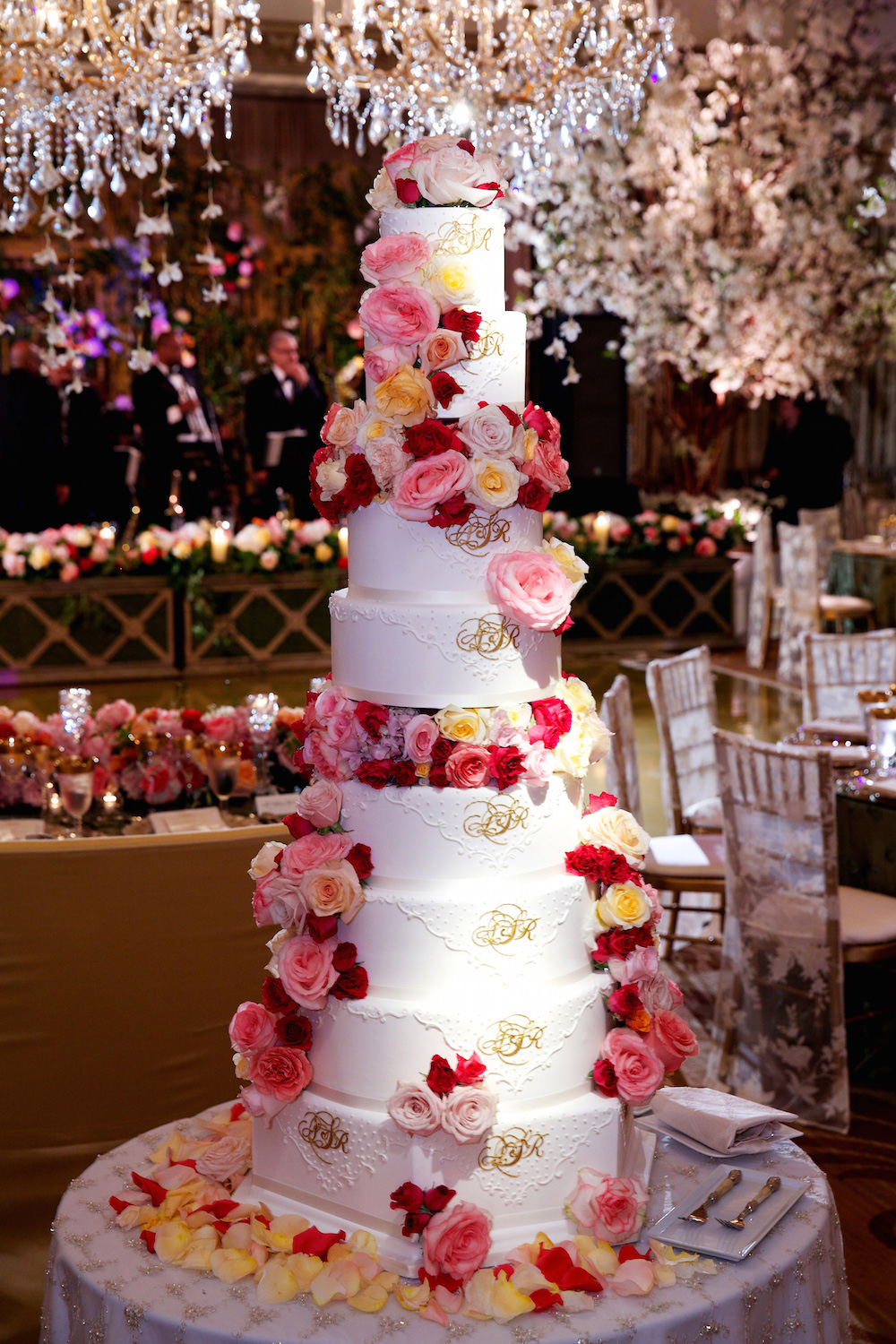 Wedding Cakes  20 Ways to Decorate with Fresh Flowers   Inside Weddings Huge and tall wedding cake with fresh red and pink flowers