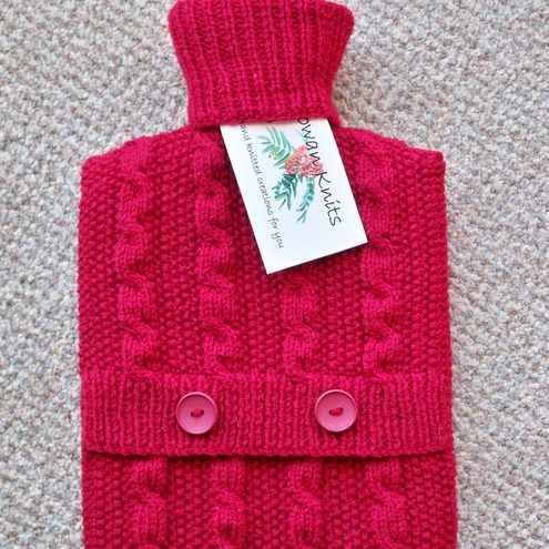 Hand knitted burgundy red hot water bottle cover