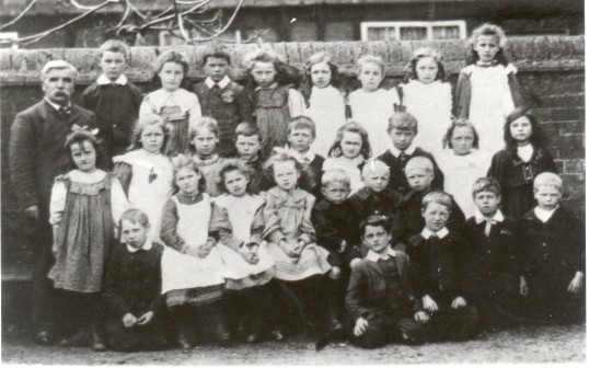 Schoolmaster Mr Marchant, with children at the Wilburton Primary School. Image: CCAN.