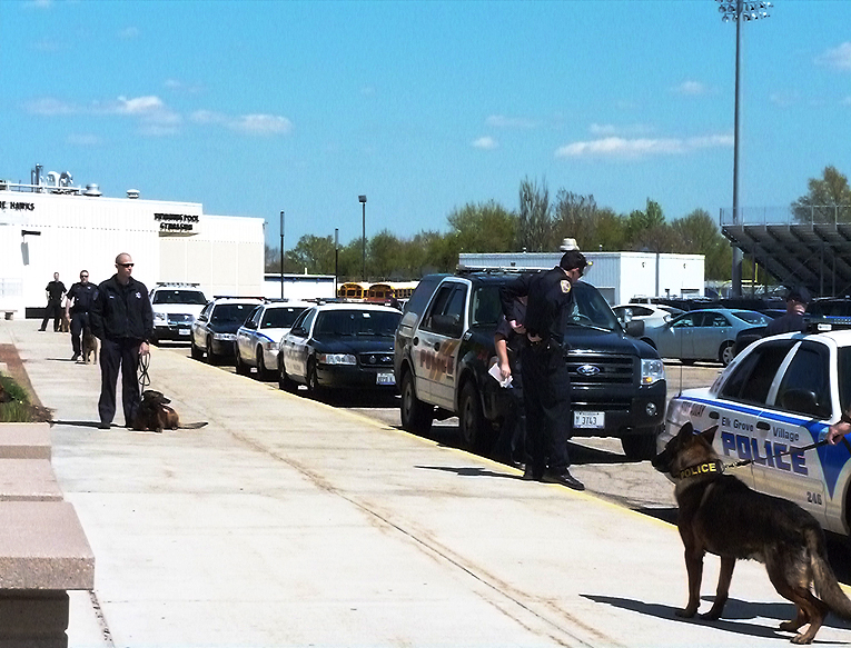 Police officers getting ready to search schools