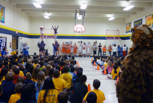 Students at Winston Churchill Elementary School showed excitement for reading while cheerleaders performed stunts.