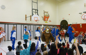 Students at Albert Einstein Elementary shoot hoops with the girls' and boys' varsity basketball teams.