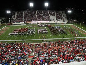 The SHS Marching Band performed at an NIU football game with nine other area high schools, as well as the NIU Huskie Marching Band.