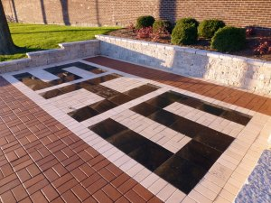 The SHS Leave Your Legacy Paver outside the main entrance of the school.