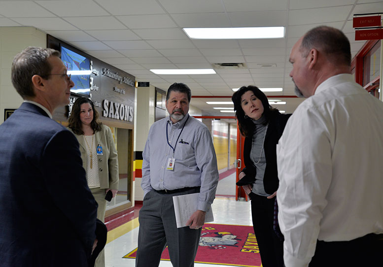 Wes Bruce (center), off-site consultant for the Illinois State Board of Education, and Margaret Horn (center-right), vice president of State Engagement & Outreach for PARCC, Inc., visited Schaumburg High School during PARCC testing on March 3. From left to Right:  Dan Cates, superintendent of Schools, Lisa Small, associate superintendent for Instruction at District 211, Wes Bruce, off-site consultant for the Illinois State Board of Education, Margaret Horn, vice president of State Engagement & Outreach for PARCC, Inc., Tim Little, Schaumburg High School Principal.