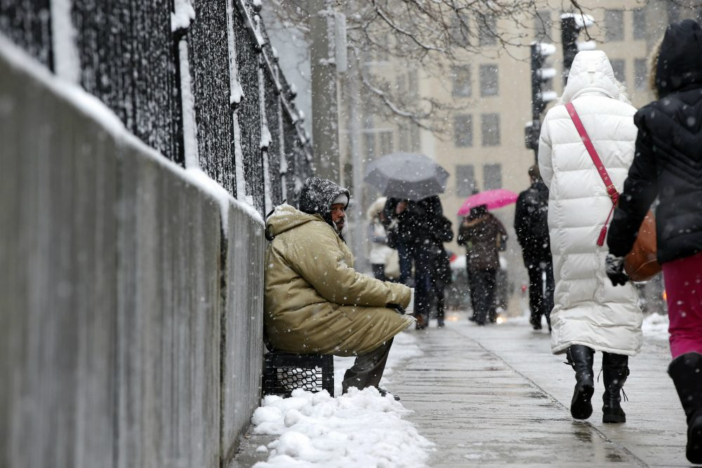 "Now more than ever, writes emergency room physician Alister Martin, we must be committed to putting patients over politics. Protecting Medicaid funding is one place to start. Pictured: George ""Big G"" Dagracia, who is homeless, solicits from passersby under light snow in Boston, Monday, March 21, 2016. (Michael Dwyer/AP)"
