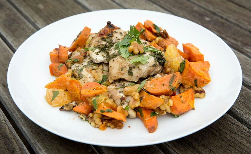 Kathy's roast chicken with sweet potatoes, carrots, tangerines and walnuts. (Robin Lubbock/WBUR)