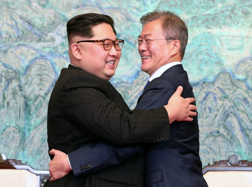 Image result for images of kim jong un hugs South Korean president