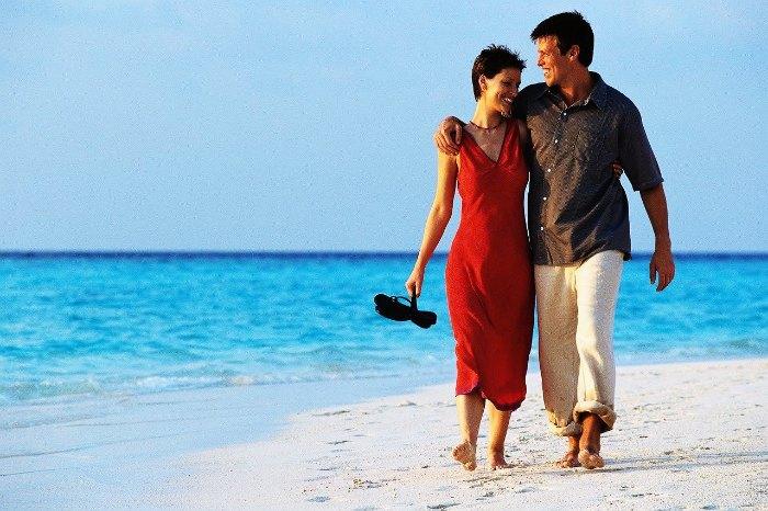 Couple on a romantic beach walk in Langkawi, Malaysia