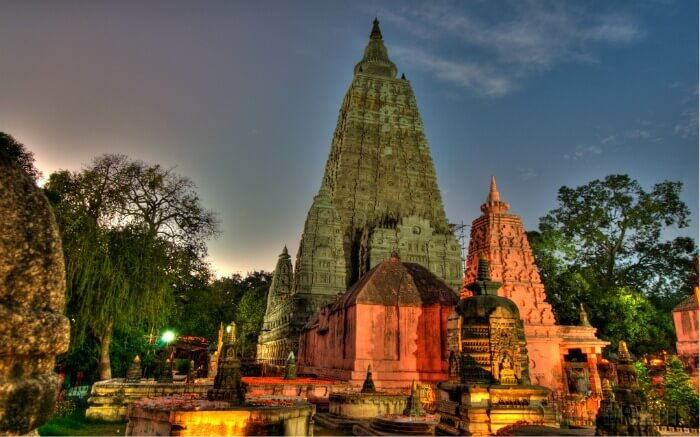 Smaller stupas and Buddha statues in the courtyard surrounding the Mahabodhi temple