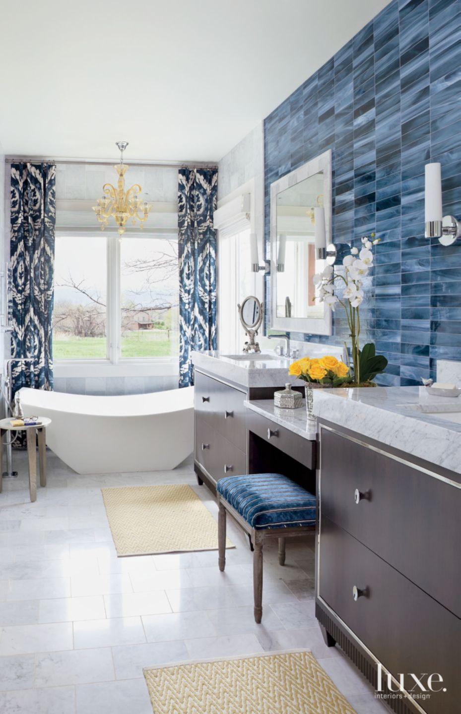 eclectic white bathroom with blue tile