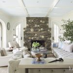 Transitional White Living Room With Stacked Stone Fireplace Luxe Interiors Design