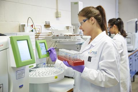 RSSL researchers perform analysis in the lab