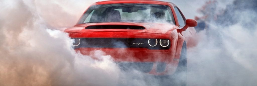 2018 dodge demon burning rubber and the smoke covering it partially