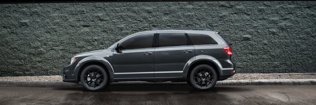 2019 Dodge Journey parked against a brick wall