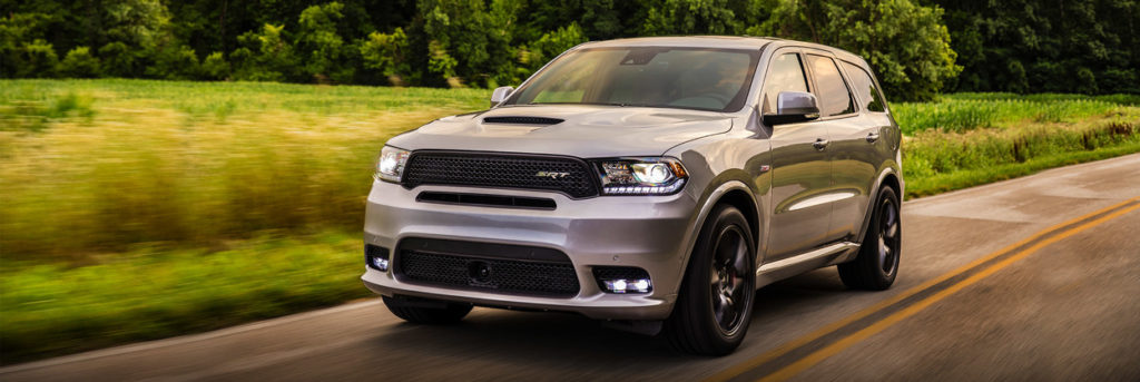 2020 Dodge Durango SRT driving in the country by a field