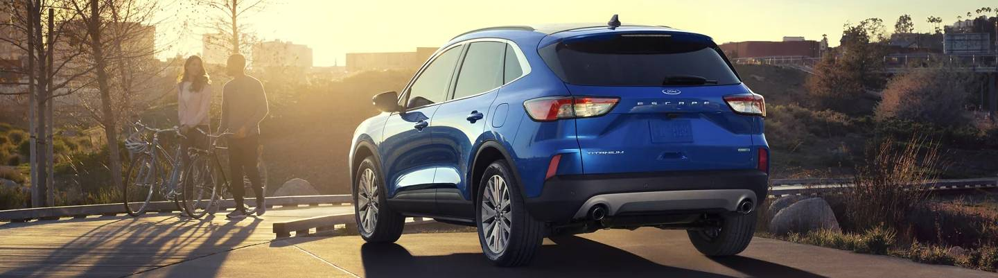 2021 Ford Escape Titanium in Velocity Blue parked in the city