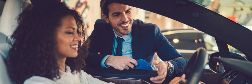 woman enjoying new car