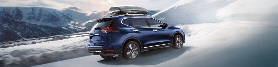Nissan Rogue® SL AWD shown in Caspian Blue with optional equipment.