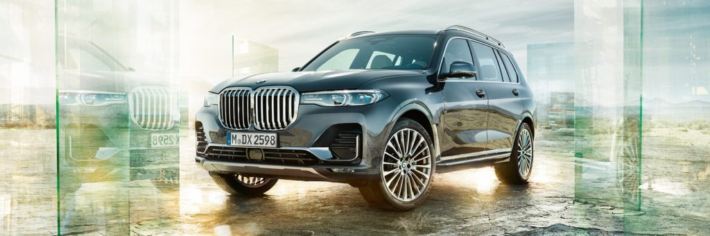 glass doors opening to the BMW X7