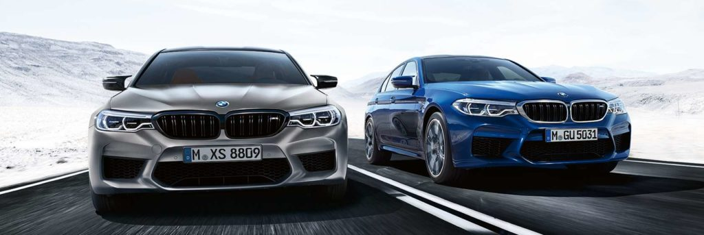 Two M5 sedans driving side-by-side