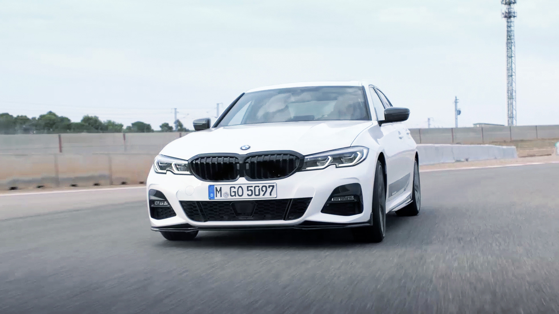 2019 bmw 3 series sedan in white on a track