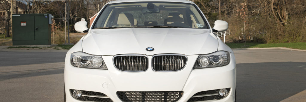 Front of a white 2011 BMW 3 Series