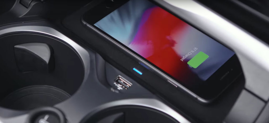 Bmw wireless charging tray under infotainment system