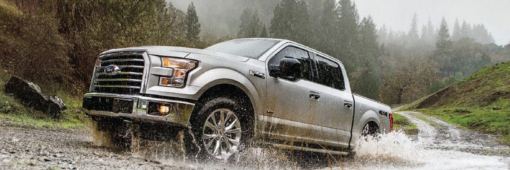 2017 Ford F-150 driving through creek