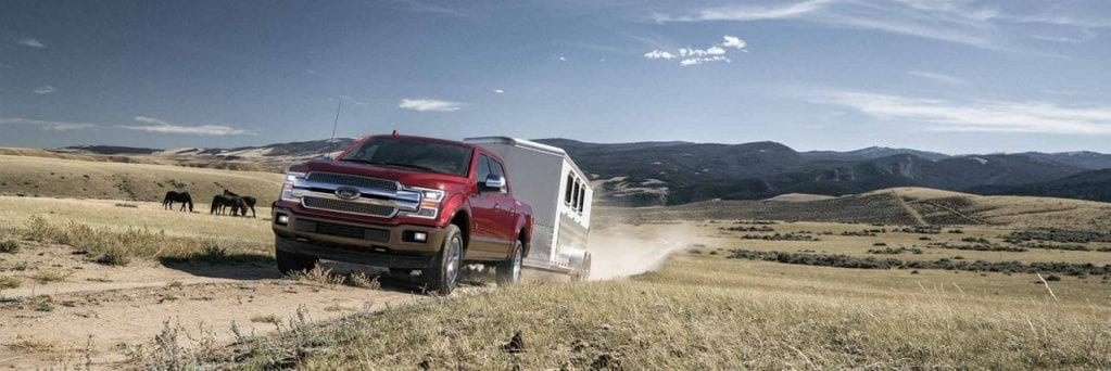 Ford F-150 Towing Trailer in Field