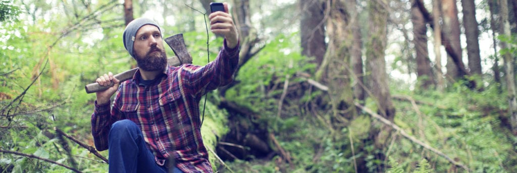 hipster posing with axe