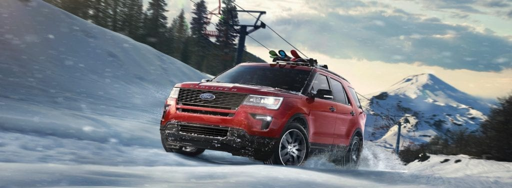 2019 Ford Explorer driving through the snow