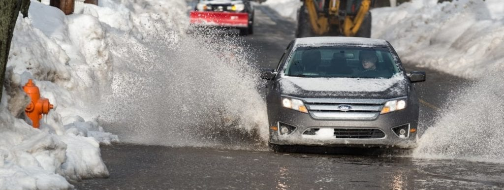 Halifax, Canada - February 2, 2015 - Drivers navigate flood waters in the aftermath of a blizzard and subsequent flooding.