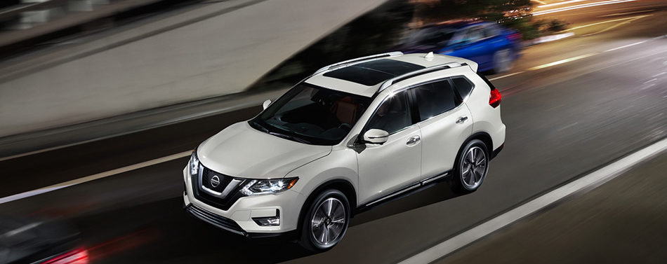 2020 nissan rogue in white, in motion on the road
