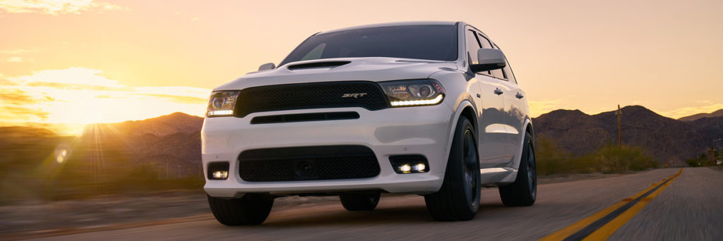 Front of White 2018 Dodge Durango SRT driving on open road