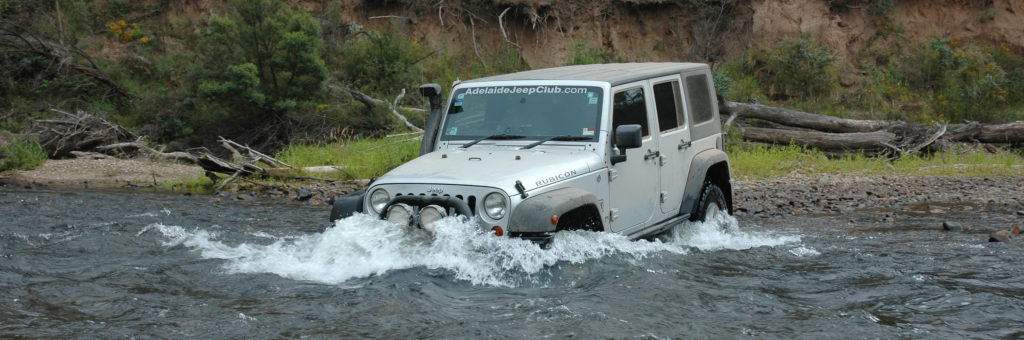 Silver 2007 Jeep JK Wrangler Rubicon Unlimited 4 door crossing a river in the beautiful High Country. Famous 4wd touring area of Australia
