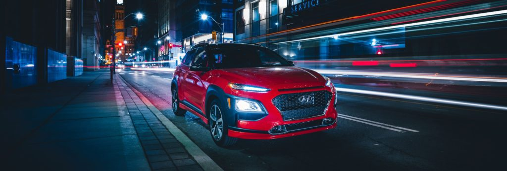 2020 hyundai kona driving down street with light effects