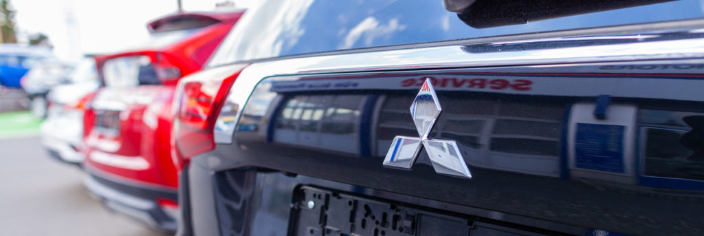 Mitsubishi logo on a Mitsubishi car at a car dealership