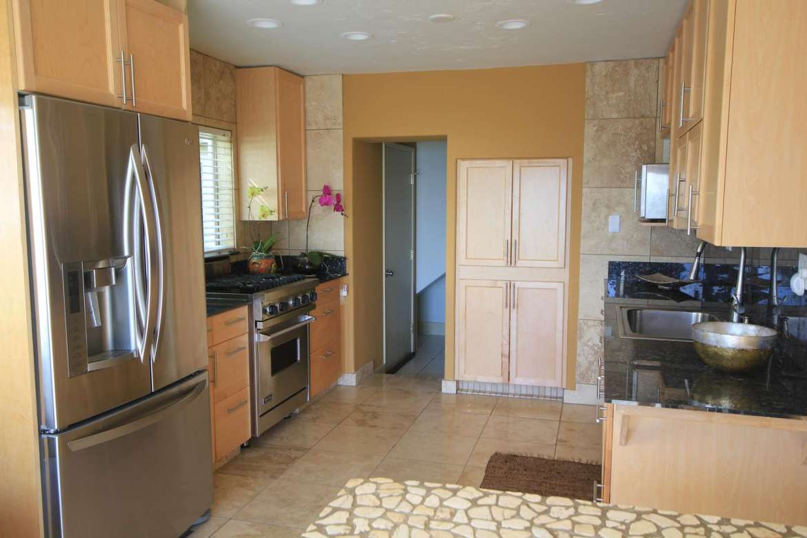 Ocean Sun kitchen, complete with professional stove and refrigerator.