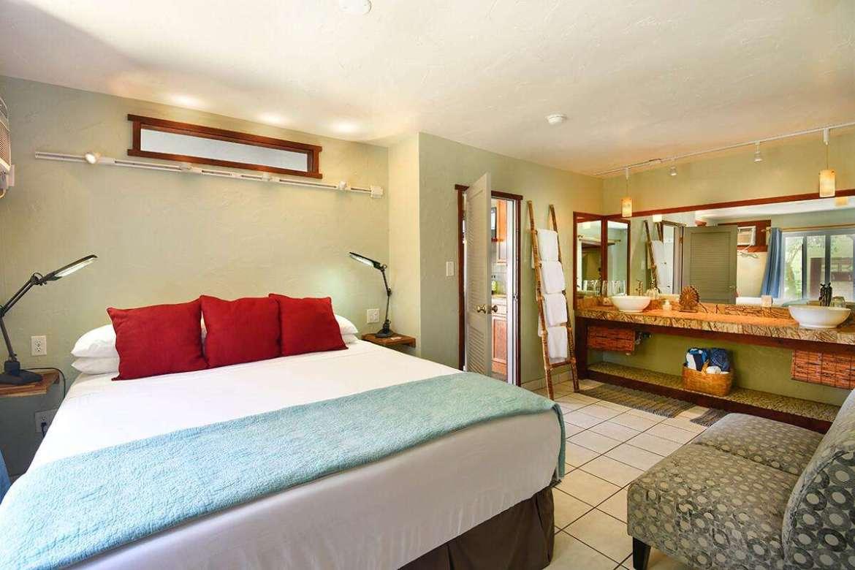 OCEAN BREEZE SUITE bedroom King bed & wall to wall vanity.