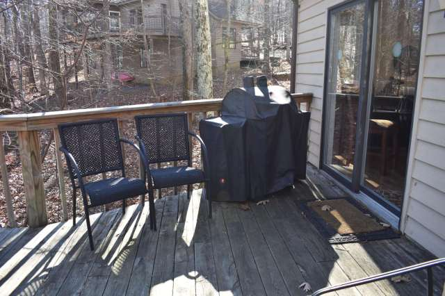 Deck off living room, propane grill 2 tables and 8 chairs