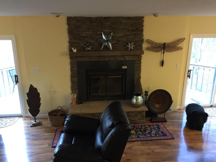 Main level living room - wood burning fireplace - leather recliners