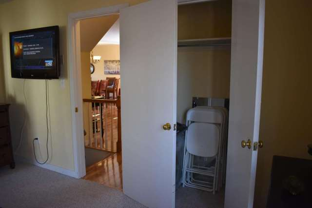 View of closet with extra card table chairs