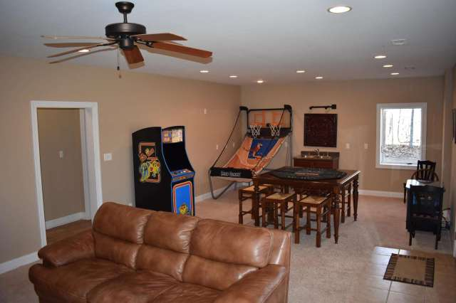 Game Room - 1st floor Family Room - TV and gas fireplace - sliding glass doors to outside