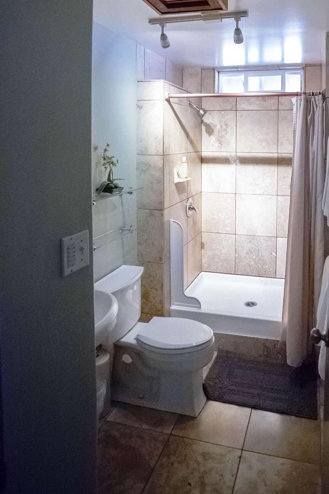 Bathroom with walk in shower.
